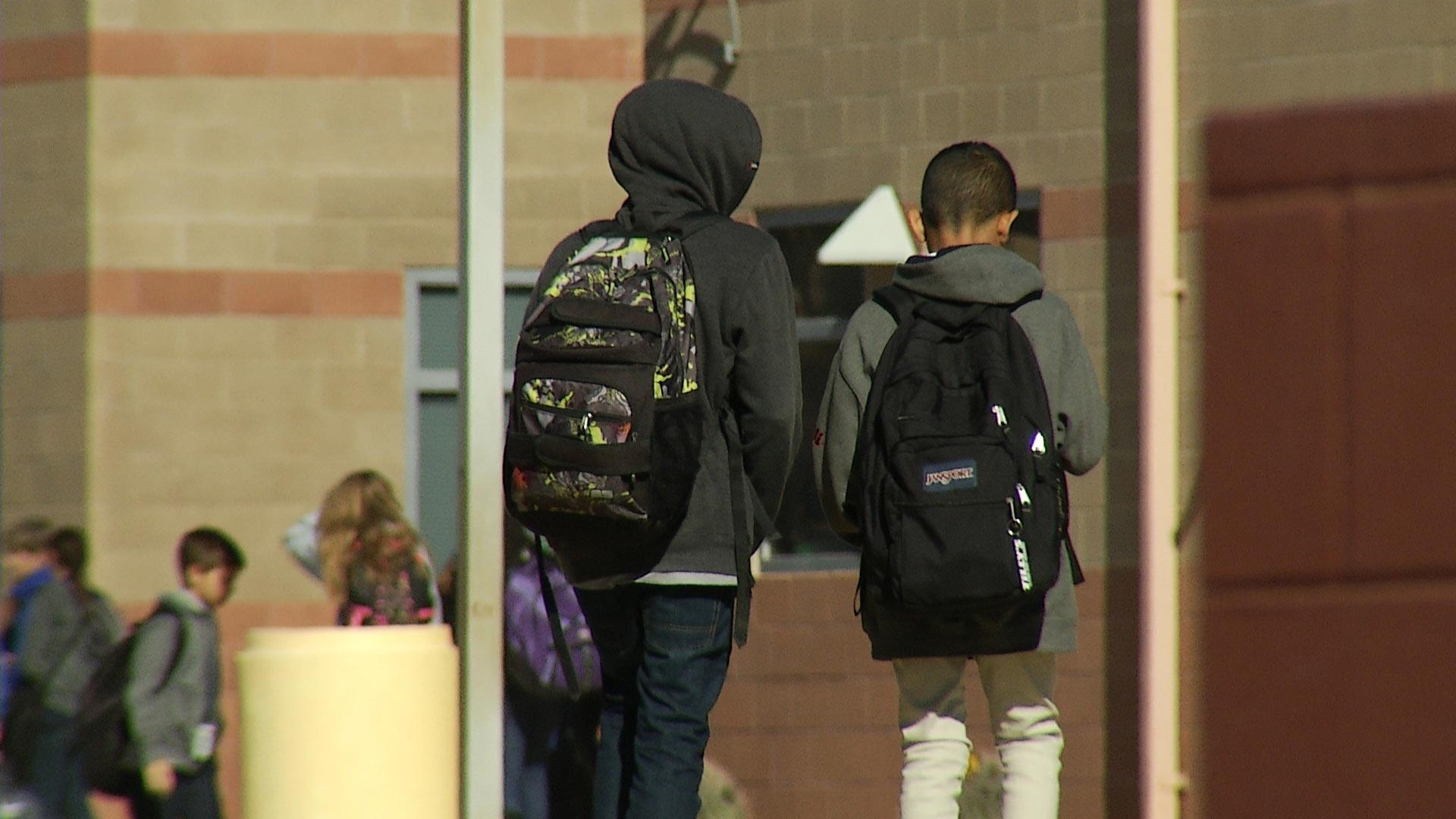 A file image of two students walking on a campus in Pima County.