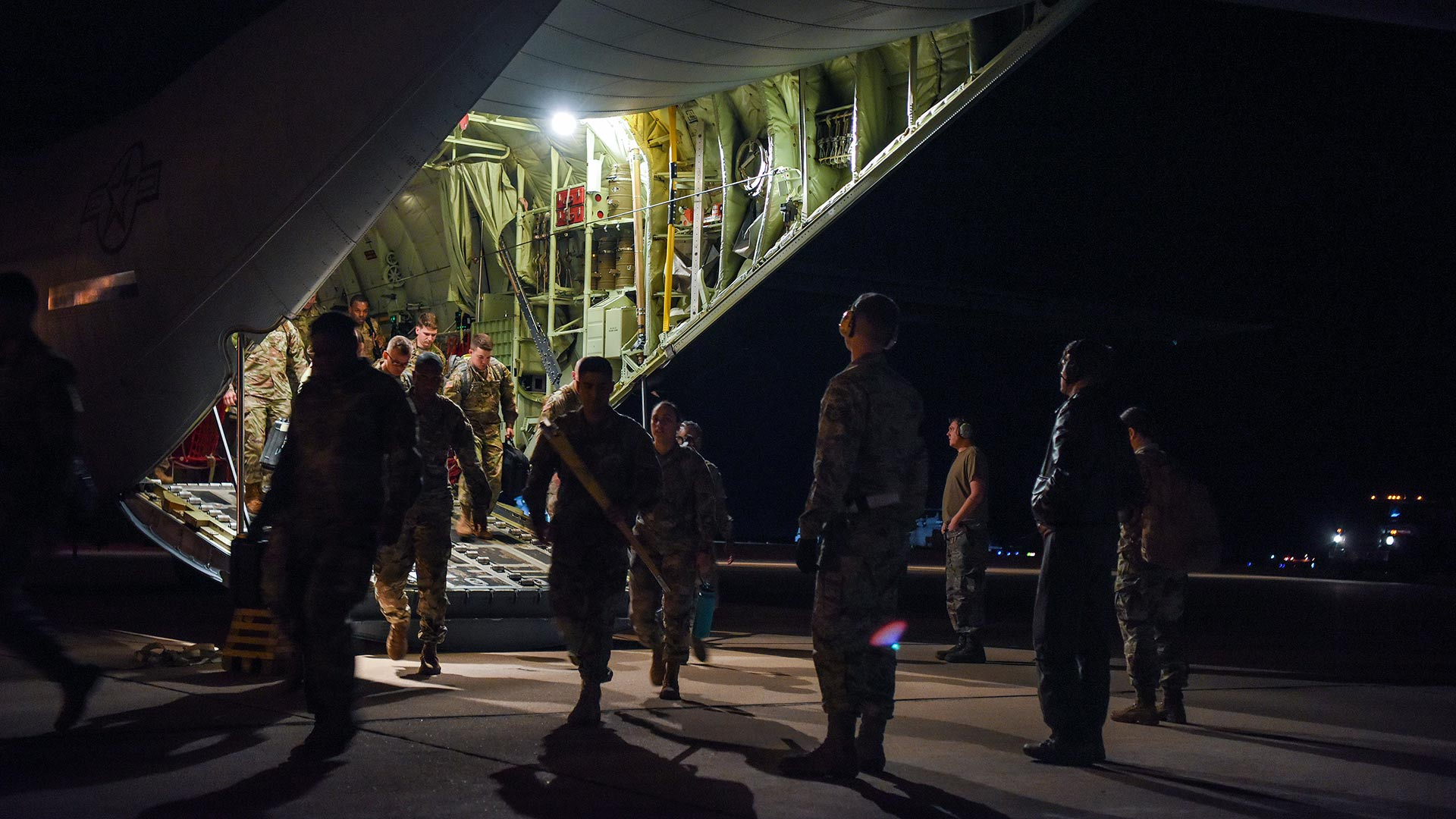 U.S. Army Soldiers out of Fort Bragg, North Carolina, arrive at Davis-Monthan Air Force Base, Nov. 2, 2018, as part of Operation Faithful Patriot.
