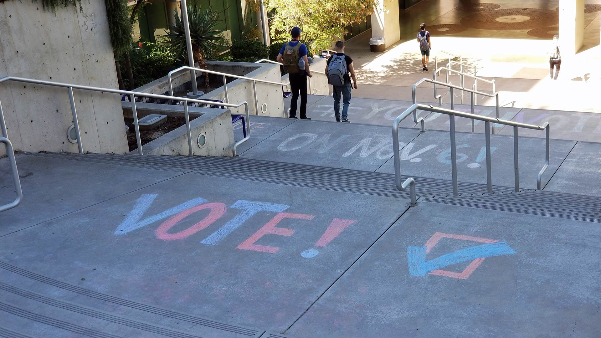 Chalk art on the stairs heading to the Integrated Learning Center on the University of Arizona campus encourages young people to vote in the upcoming election.
