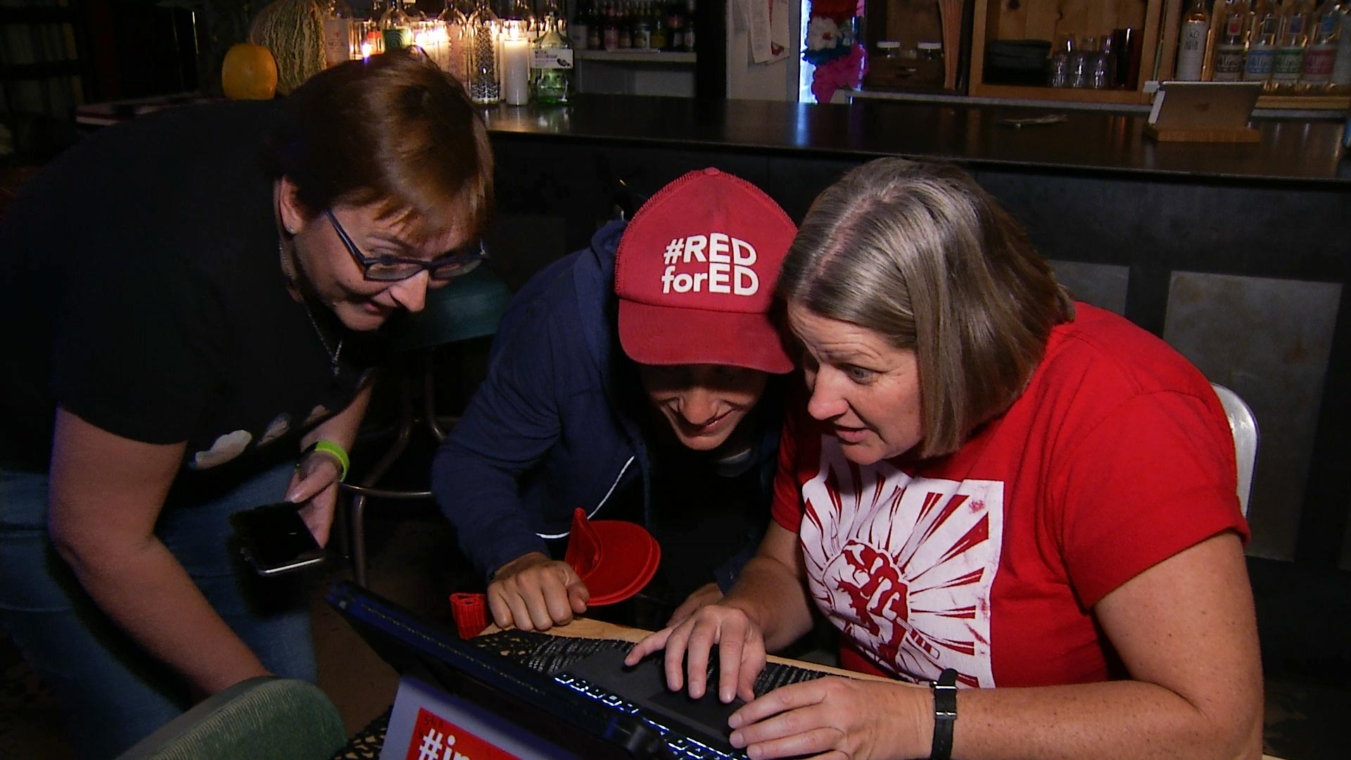 Members of Tucson's #RedforEd education advocate community gather Nov. 6, 2018, to watch the results of the election.