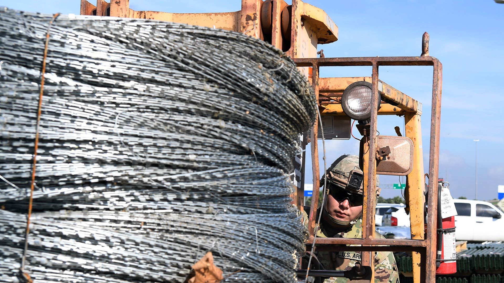 A soldier transports concertina wire destined for a section of border near McAllen, Texas, Nov. 5, 2018.