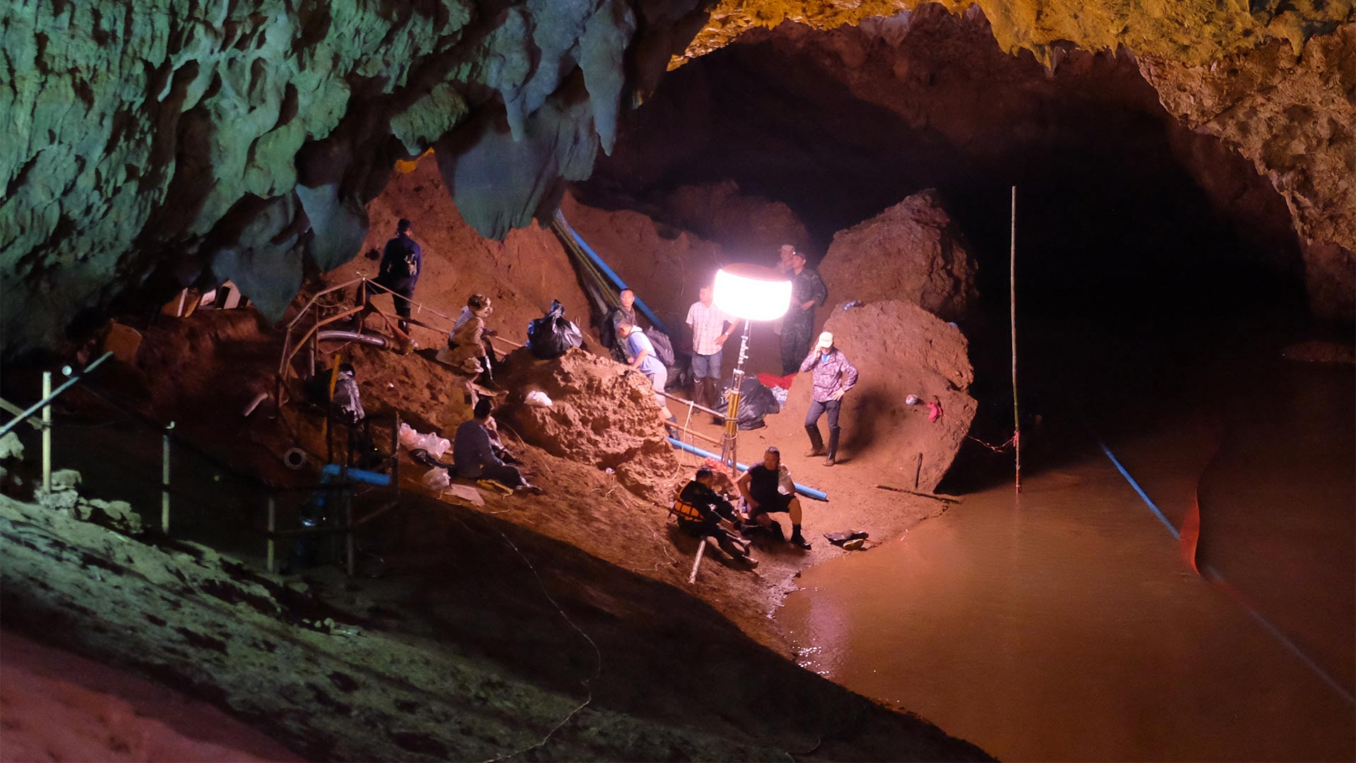 Thai officers supervise the rescue mission inside Tham Luang Nang Non cave on June 28, 2018 in Chiang Rai, Thailand.