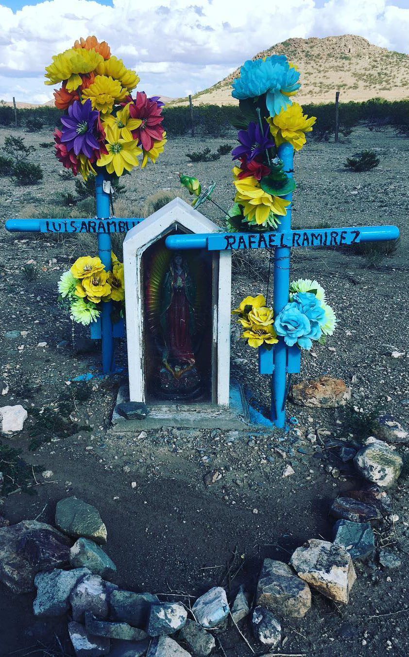 """New Mexico I-10 mile marker 16 Eastbound. A freshly painted shrine for Rafael and Luis, the Virgin watches me through the plexiglas from her post between the crosses marking the passage of these two travelers, the paint is so fresh the dirt is still blue. It's good to know you are loved."" - Jesse Sensibar"