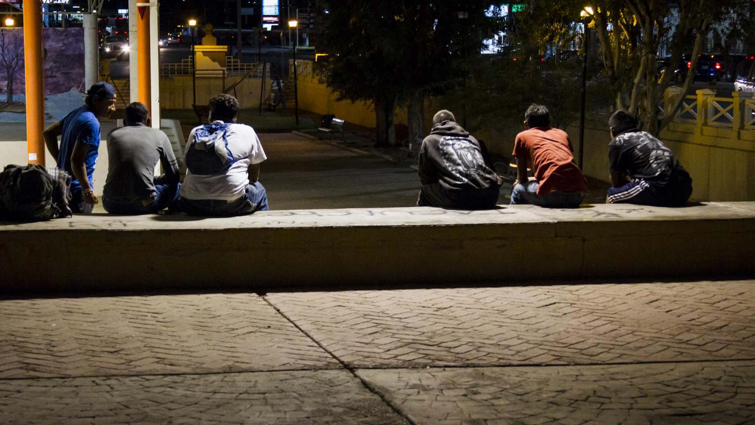 Honduran migrants hang out in a central plaza in Sonoyta, Mexico, across the border from Lukeville, Arizona.