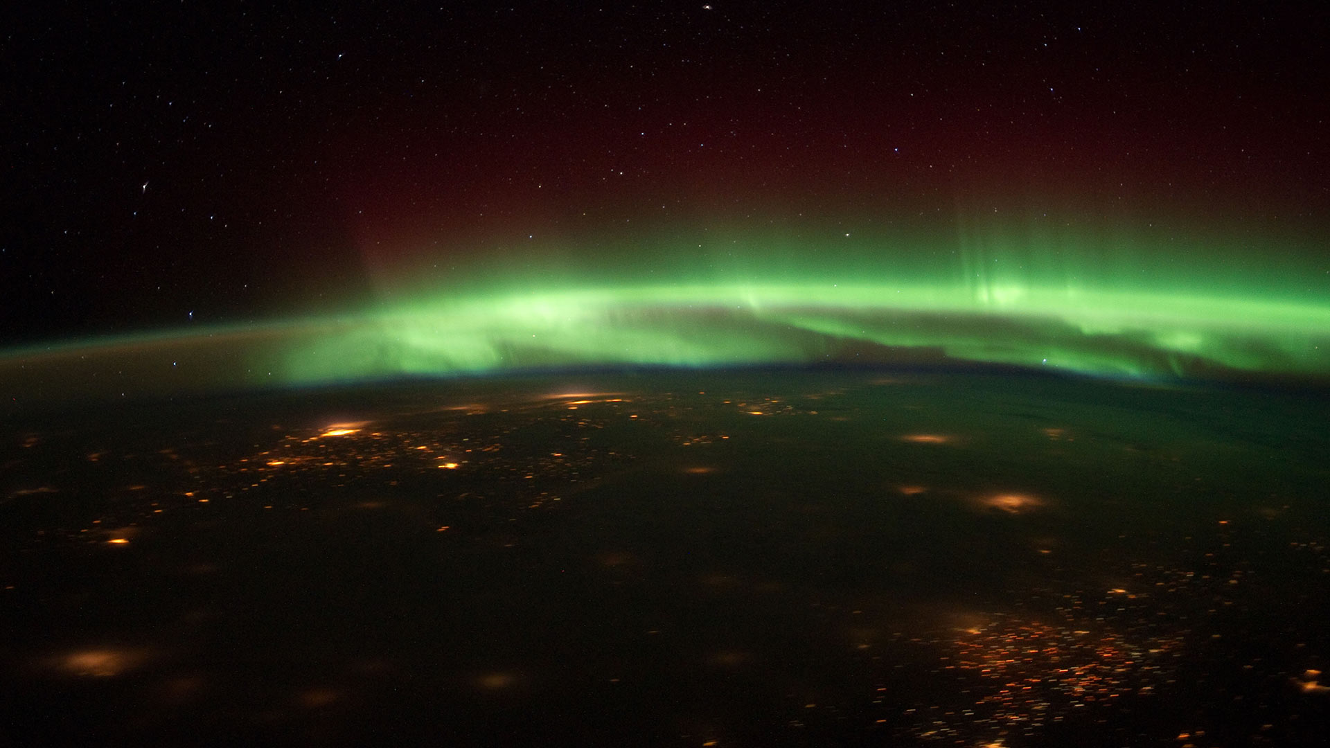 The Aurora Borealis dances over the U.S. Midwest Jan. 25, 2012, from the vantage point of the International Space Station.