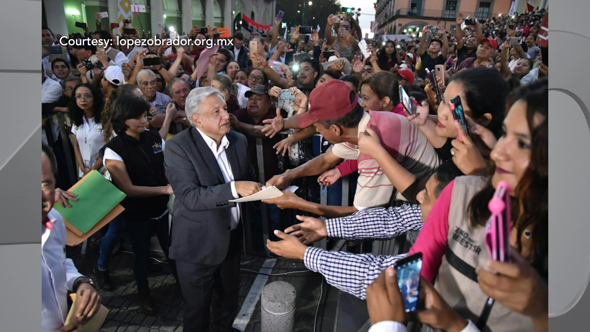 Mexican President Andres Manuel Lopez Obrador greets supporters.