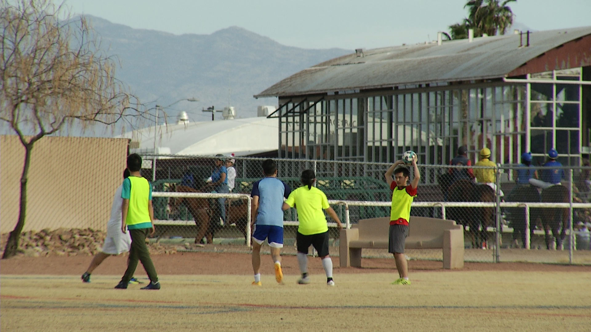 Soccer and horse racing co-exist at Rillito Park Racetrack.