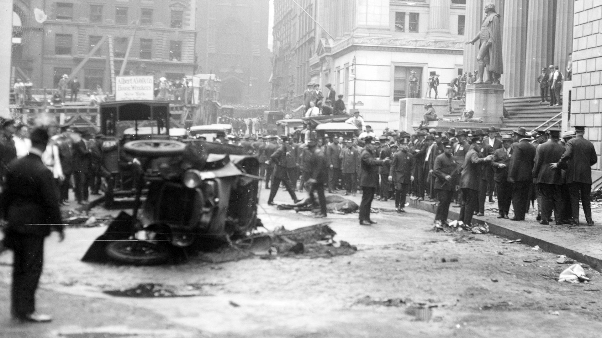 The blown-out car and deceased horse on Wall Street after the bombing, September 16, 1920.