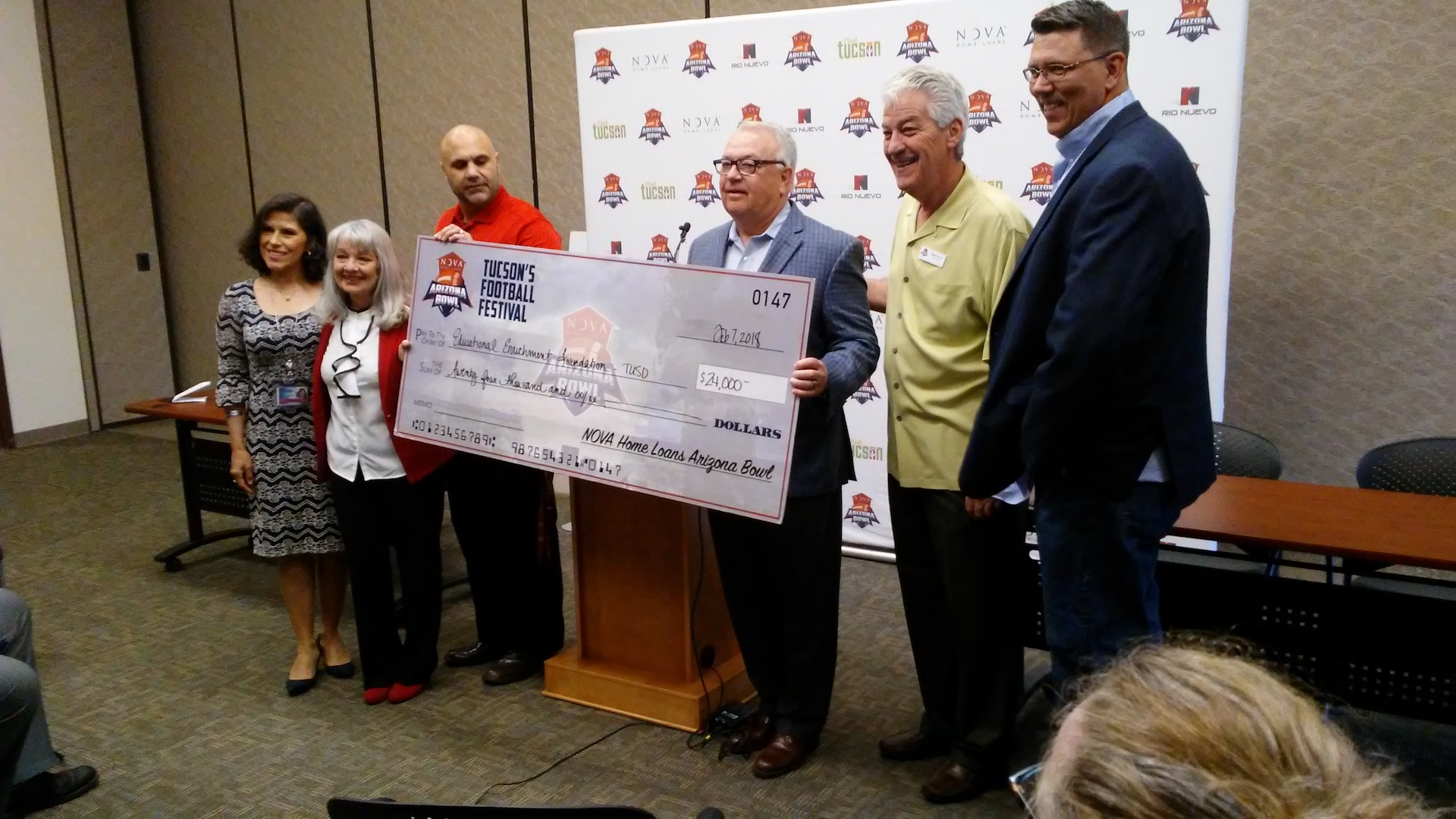 Arizona Bowl executive director Alan Young (third from right) delivers a donation to a Tucson teachers' foundation.  The money came from net proceeds gathered at the 2017 football bowl game.
