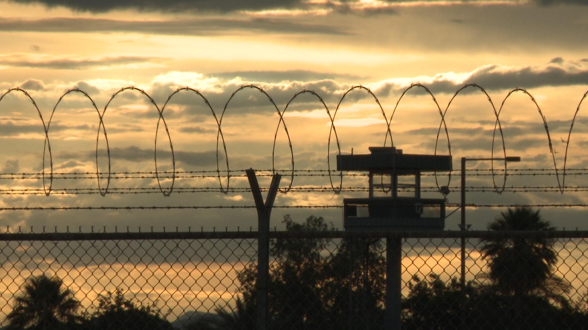 Barbed wire around a detention center.