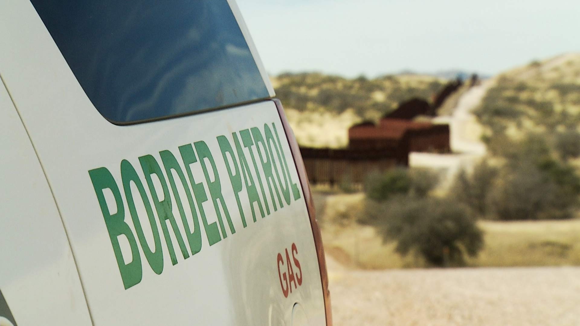 A Border Patrol vehicle at the fence on the U.S.-Mexico border near Nogales.
