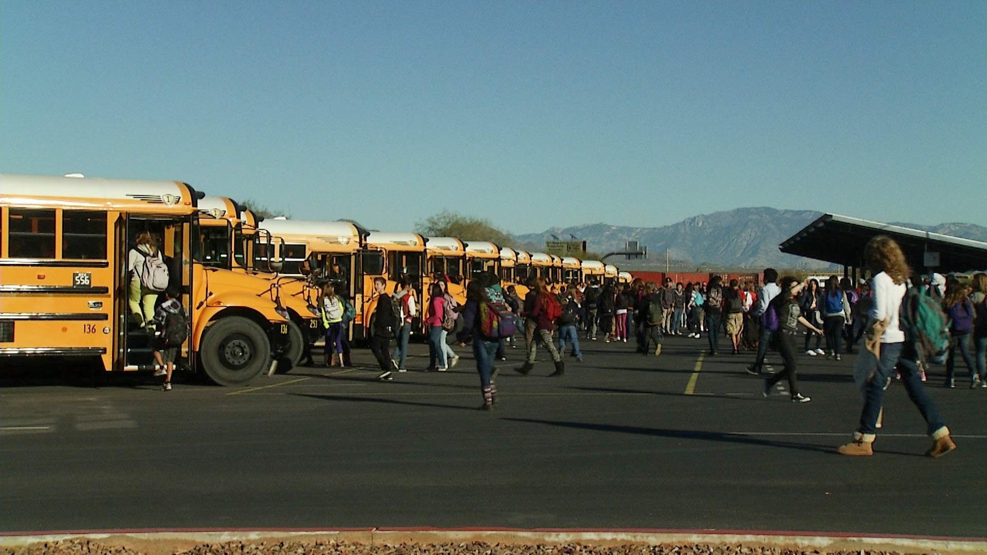 Tucson students head to buses after getting out of class.
