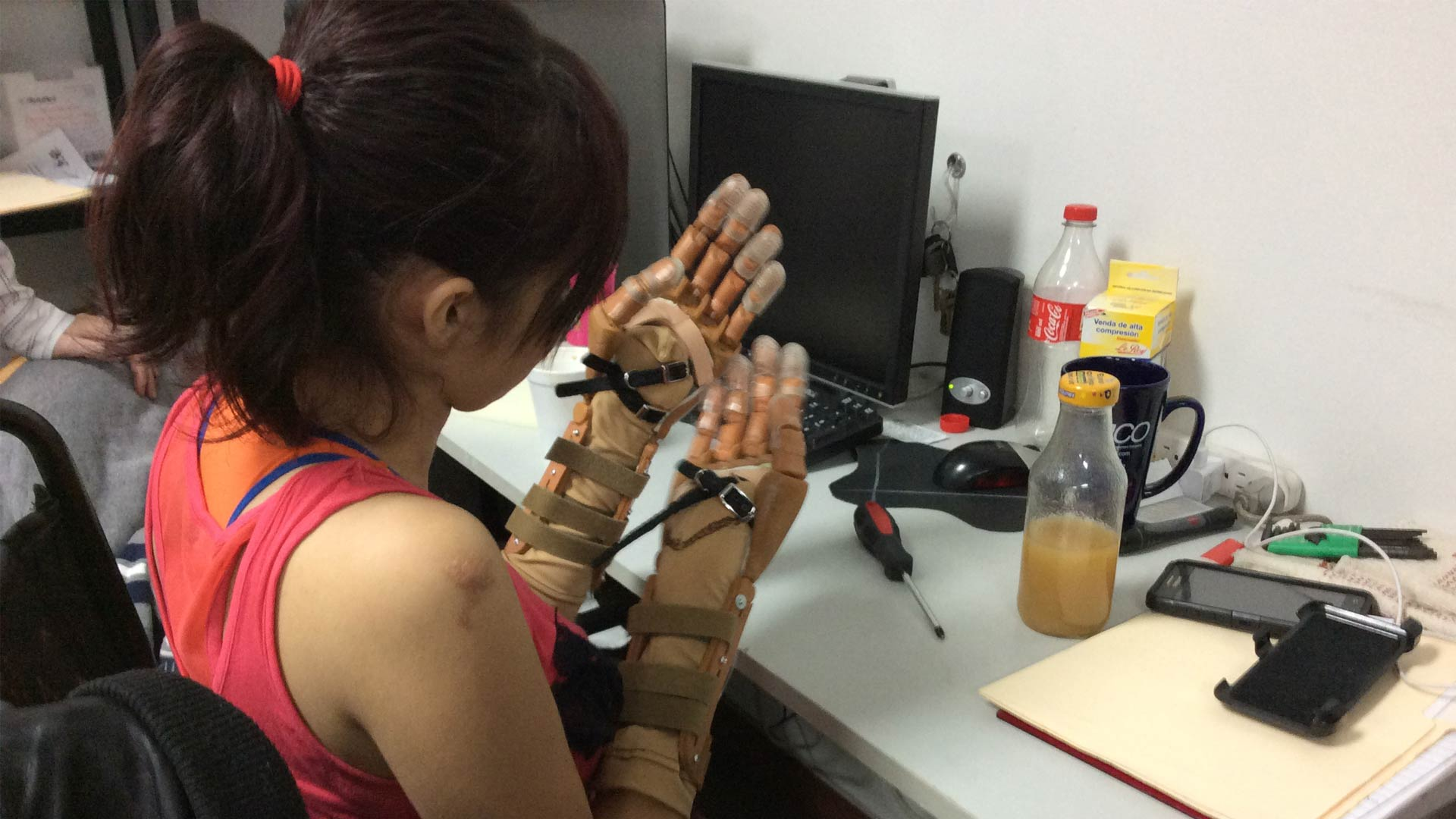 A girl tries on prosthetics designed by Arsobo.
