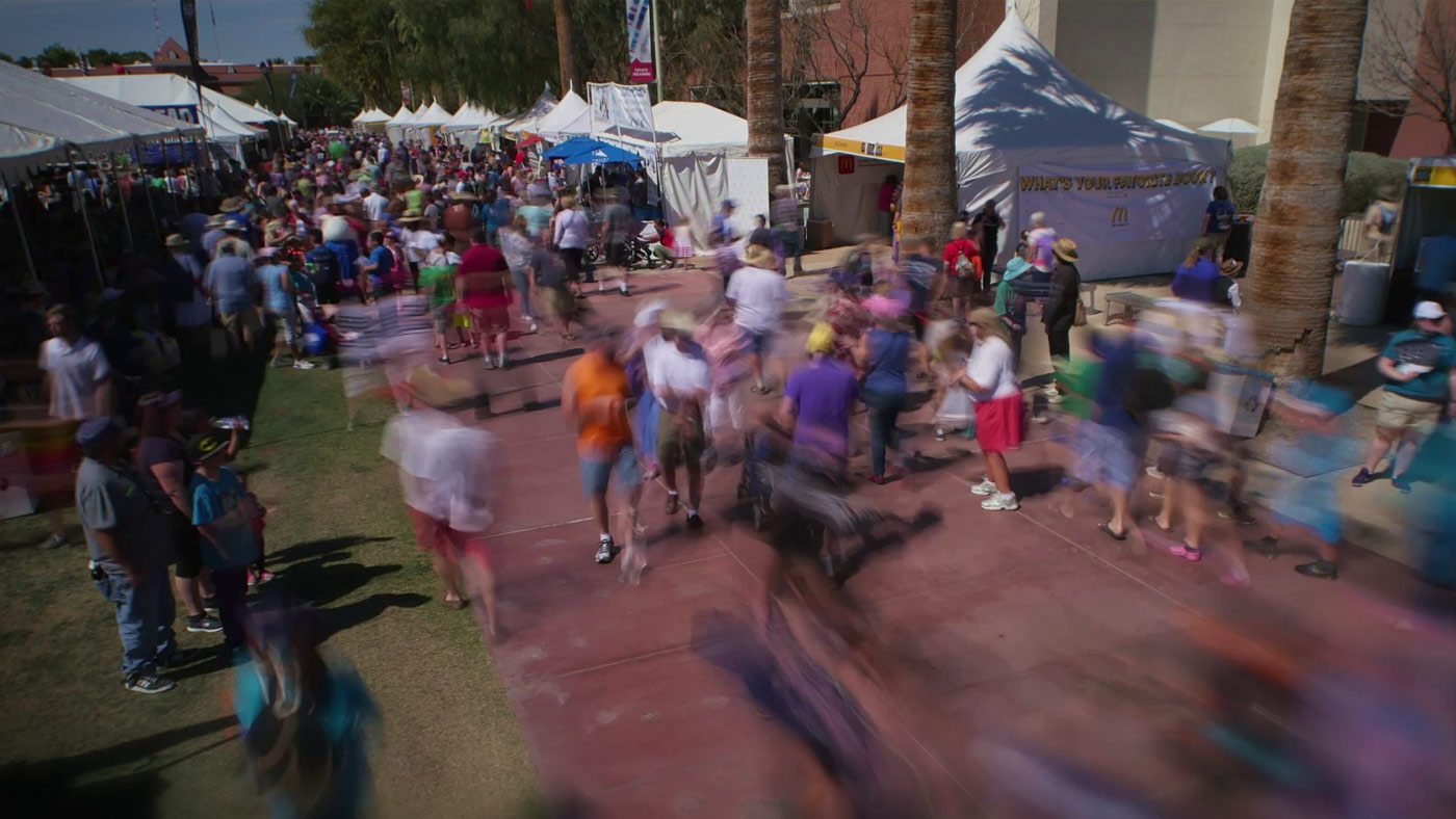 Crowds of people enjoying the sunshine Tucson Festival of Books. From March 2017.