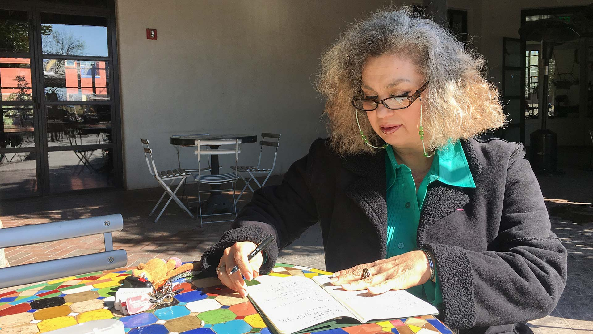Ana Abril Tolsa, a woman who has lived in Tucson for 19 years without legal status, writes at the Mercado San Agustin on Feb. 22, 2018.