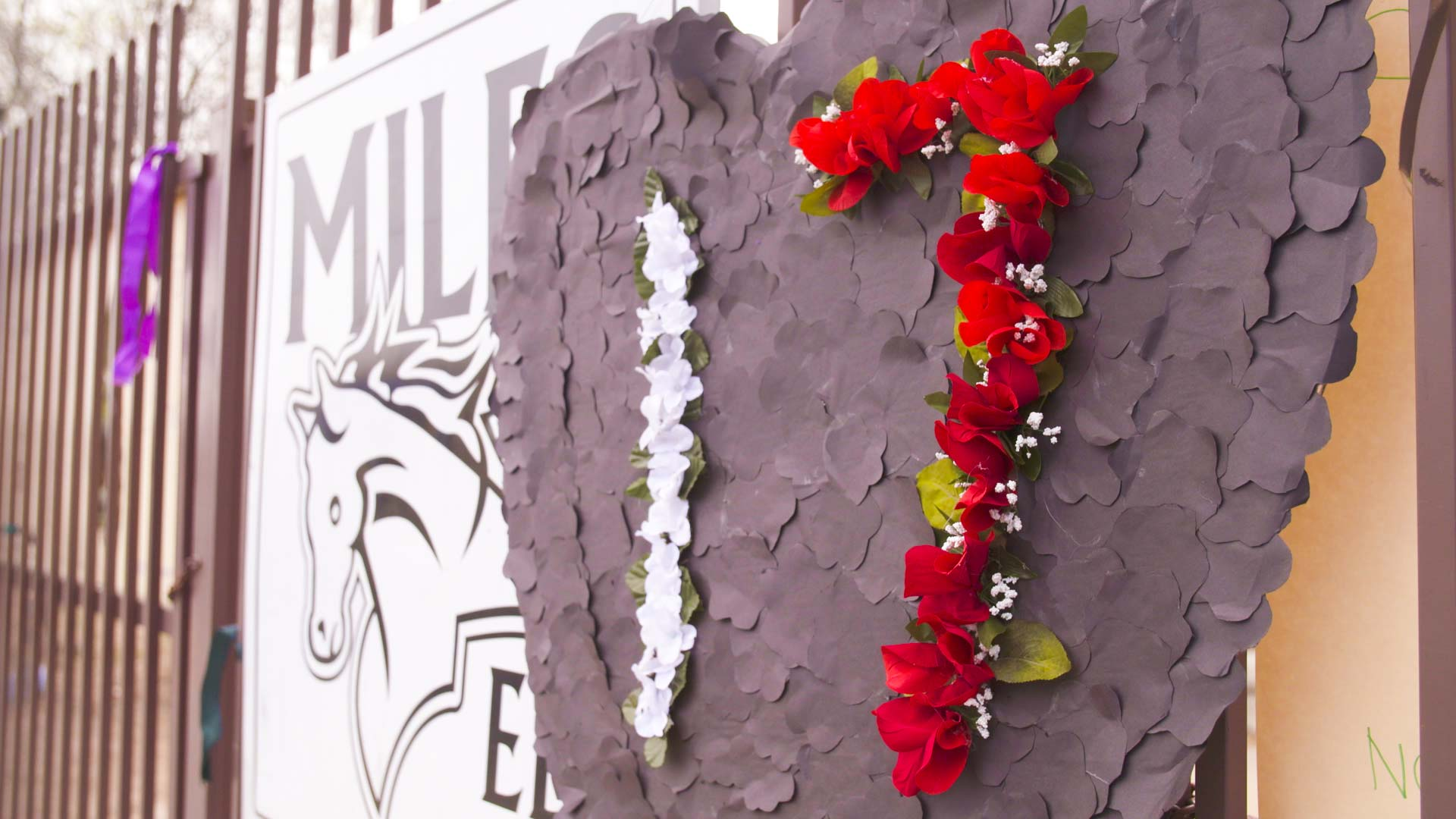 """A sign put up March 14 at the Miles Exploratory Learning Center in Tucson reading """"17"""" in remembrance of the 17 people killed in a Parkland, Florida, school shooting one month before."""