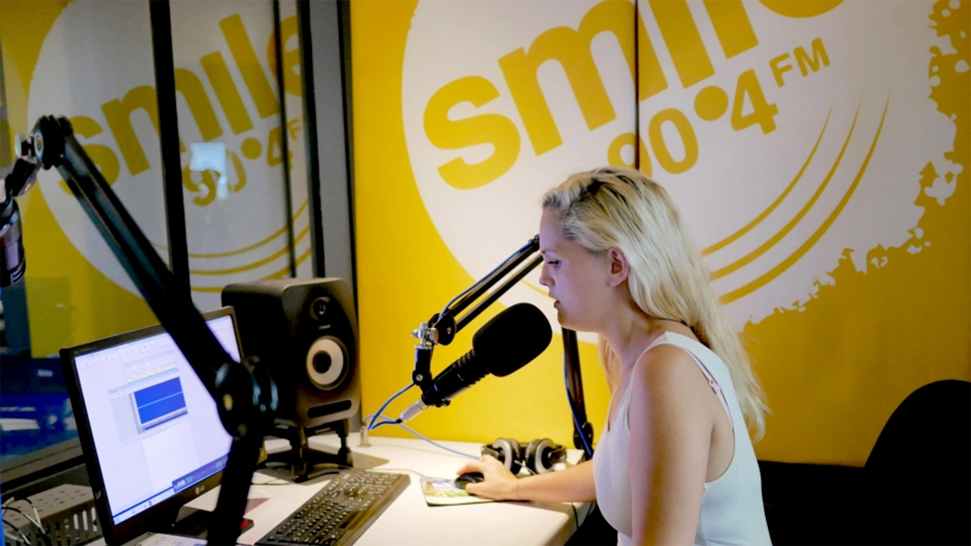 Saya Pierce-Jones records a recent report on Cape Town's water crisis for Smile 90.4FM radio. In more than a year on the full-time water beat, Pierce-Jones has helped listeners understand the roots of the crisis and find ways to dramatically cut their water use.