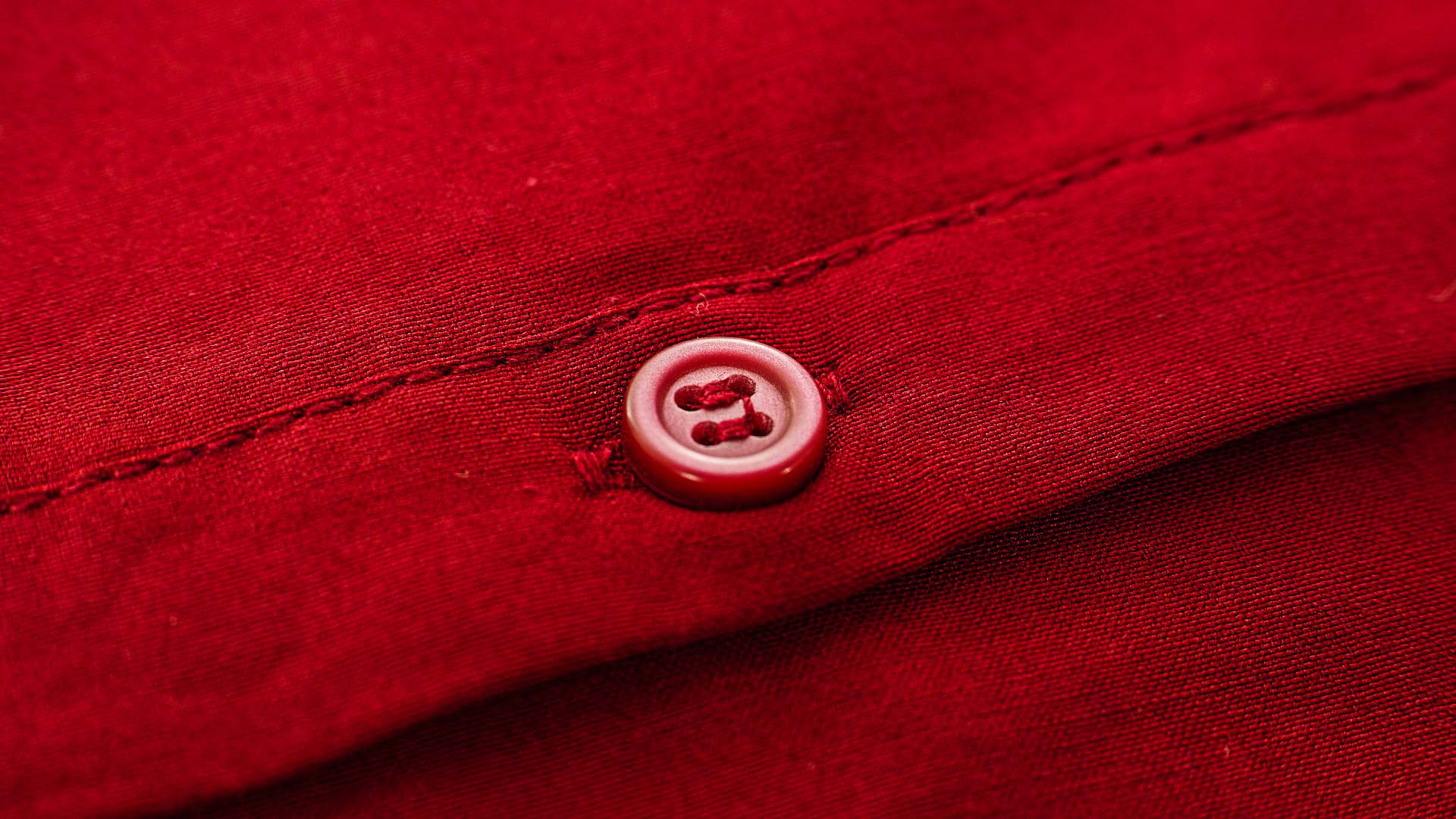 A button on red fabric.