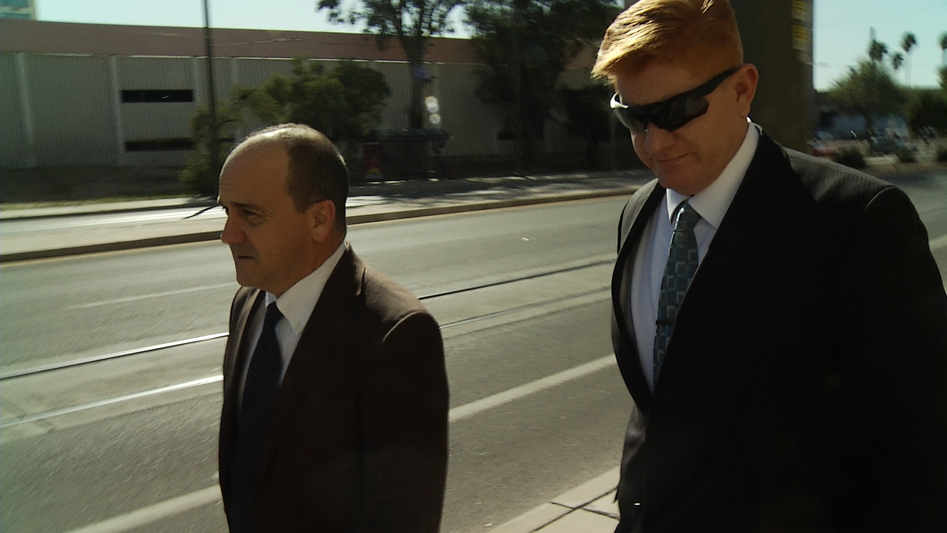 Border patrol Agent Lonnie Swartz (on right) walks into federal courthouse with attorney.