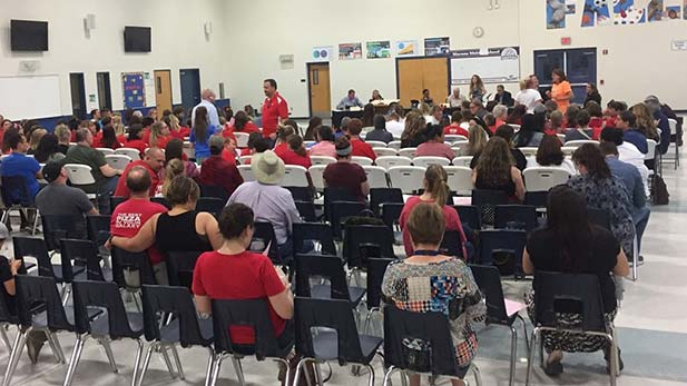 The Marana Unified School District hosts its board meeting in the Marana Middle School cafeteria to vote on closing Thornydale Elementary.