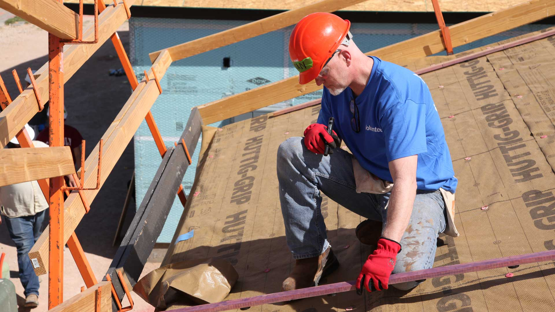 Brian Deevers, AZPM Graphic Designer helps on a Habitat for Humanity build.