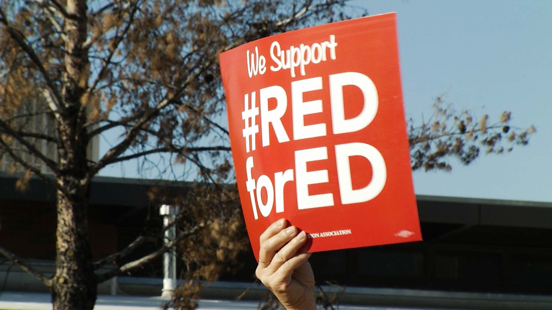 A sign reading #RedforEd, a hashtag promoting a campaign to increase education funding in Arizona.