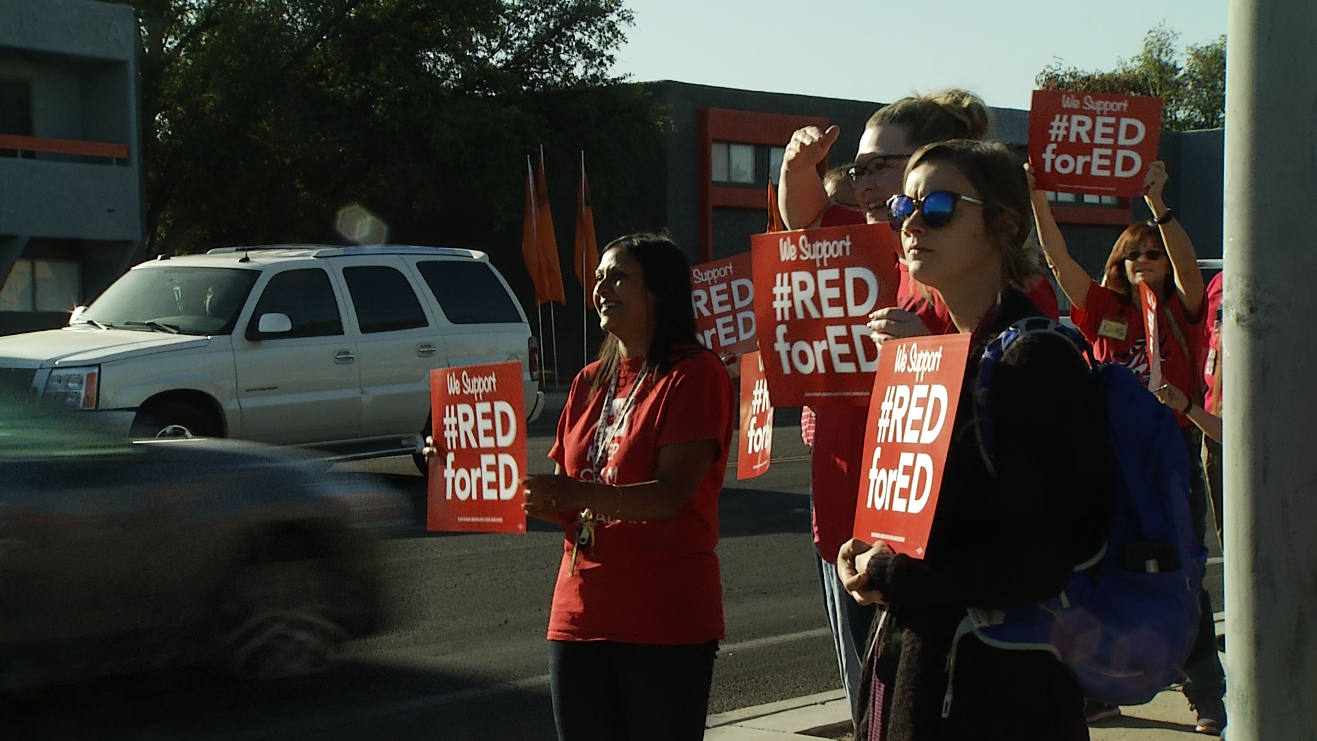 Teachers stage a walk-in demonstration outside Amphitheater High School in support of Red for Ed.