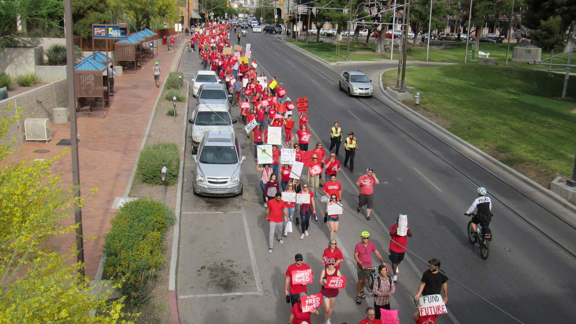 Hundreds of teachers and families march down Congress street chanting for better teacher pay and funding for education.
