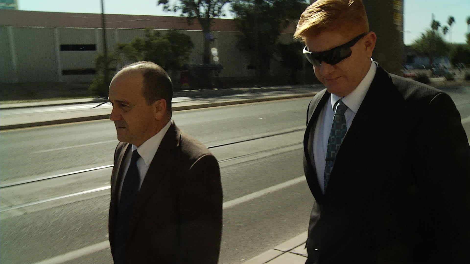 Border Patrol agent Lonnie Swartz, right, walks into federal courthouse with his attorney, April 2018.