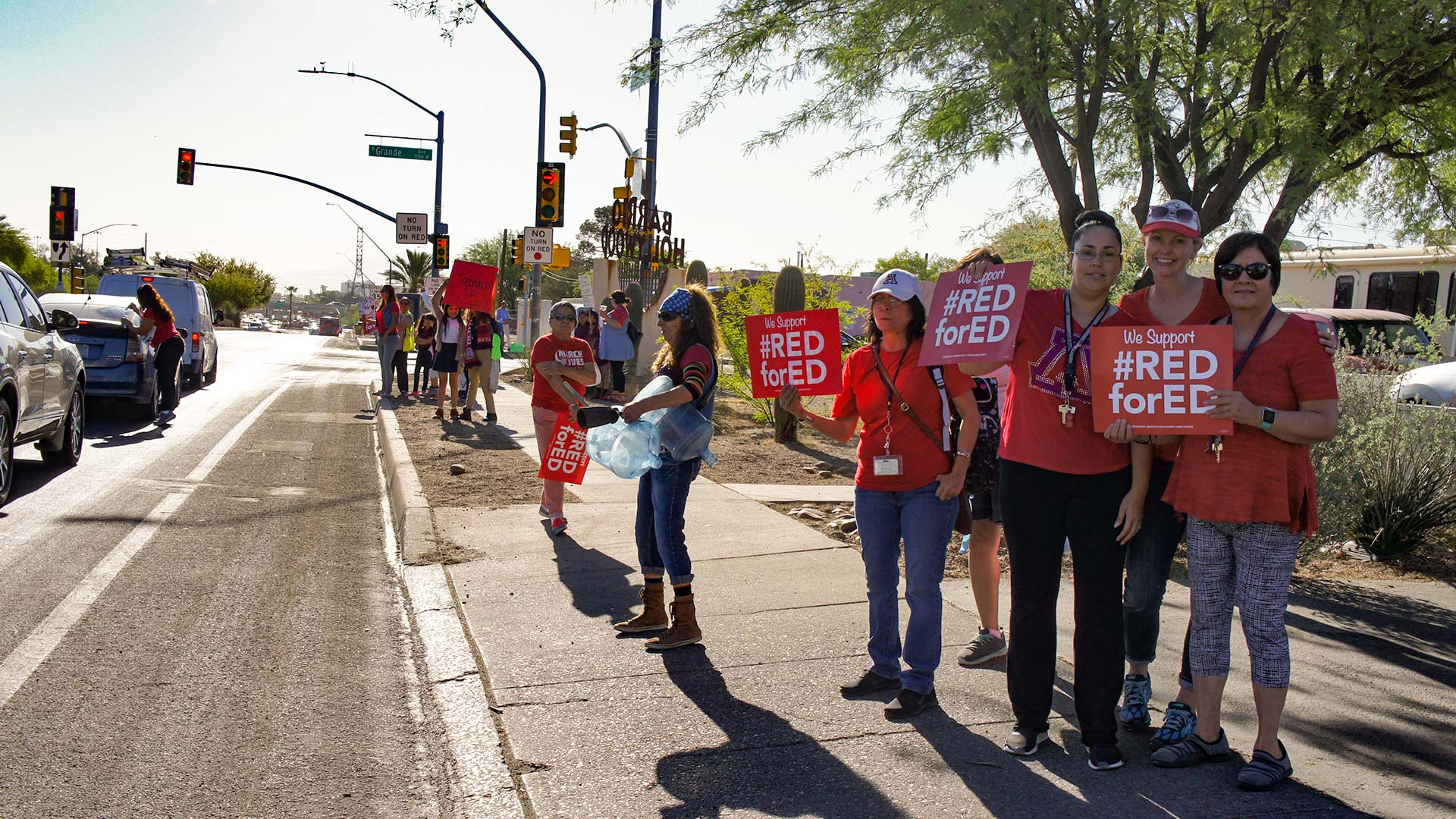 Educators protest before school on Tuesday, April 24, with #RedForEd signs in Tucson's Barrio Hollywood.