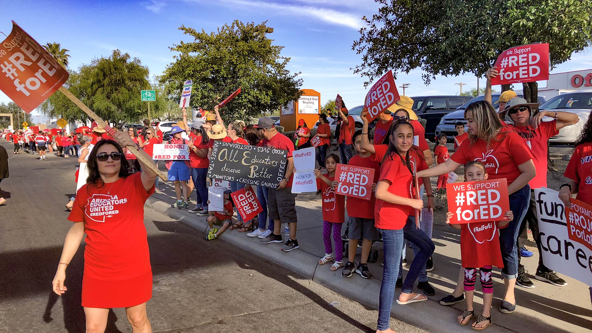 Demonstrators gather on Broadway in Tucson April 25, 2018 to protest for more state education funding, one day before a walkout that closed schools all over the state.