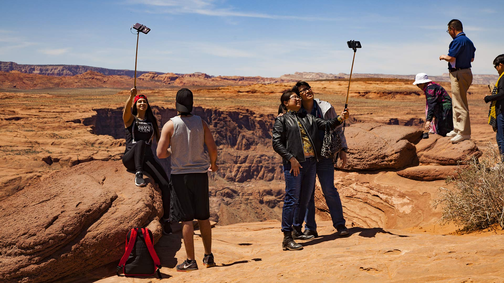 Tourists snap selfies at the iconic Horseshoe Bend, near Page, Arizona, April 2018.