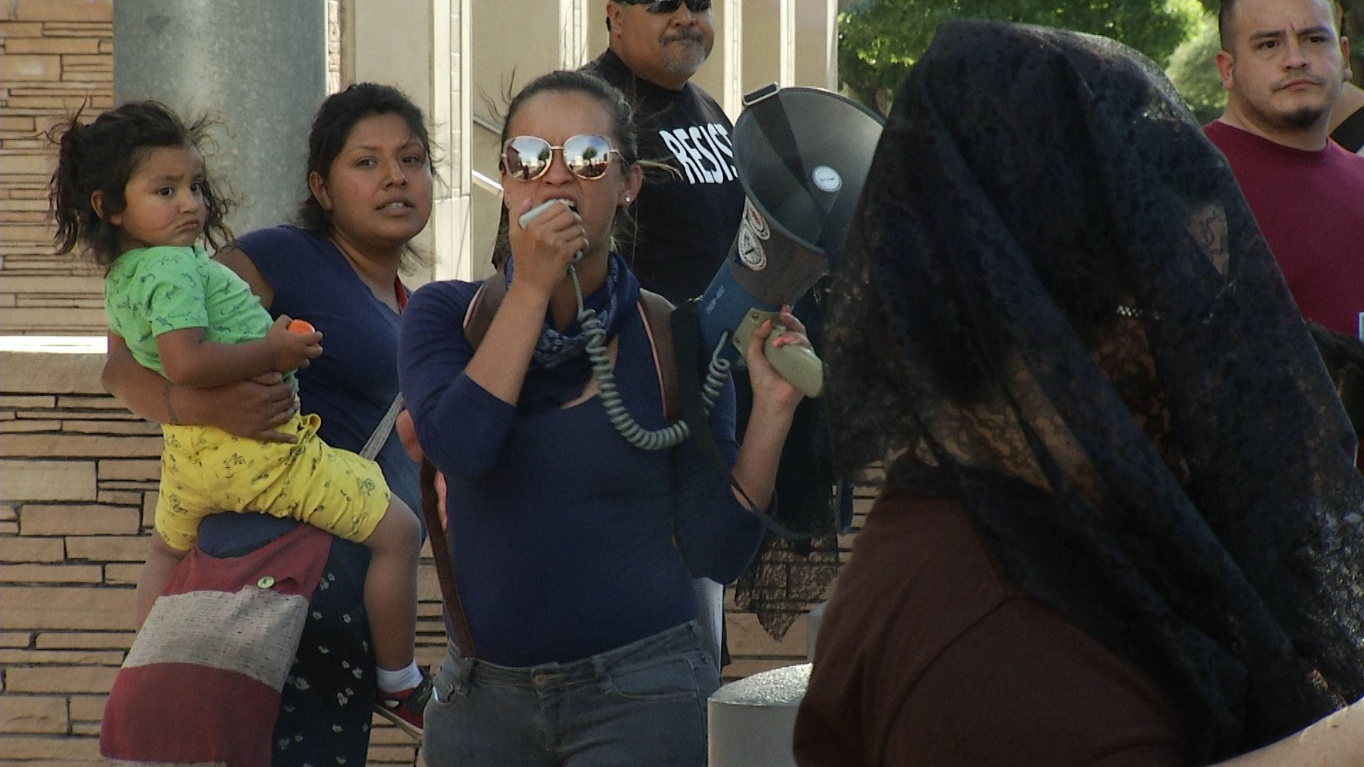 Protesters react to the not guilty verdict handed down in the second-degree murder trial of Border Patrol agent Lonnie Swartz outside of federal courthouse in Tucson.