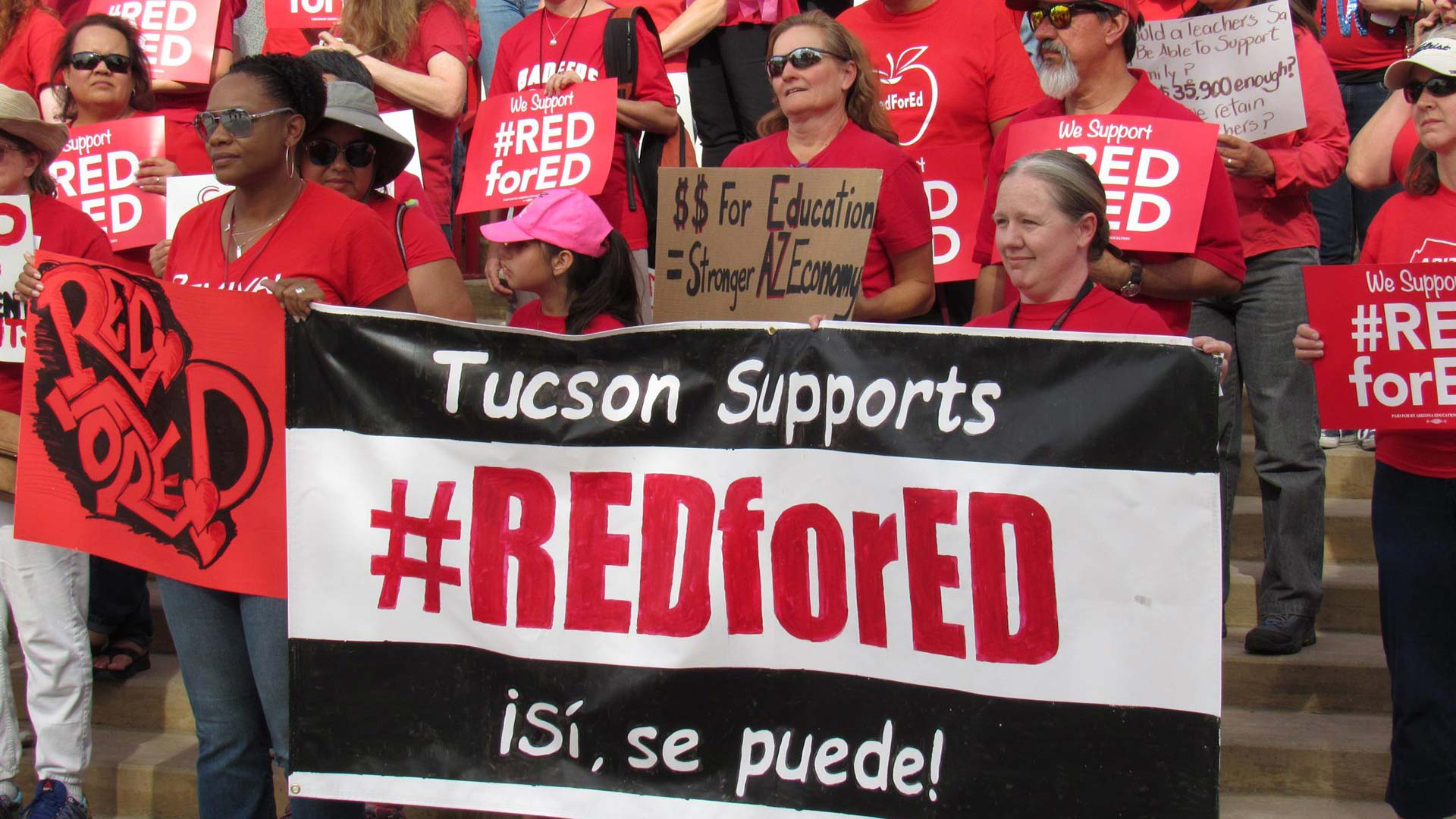 Teachers gather on the steps at Tucson High before walking downtown to protest for better pay.