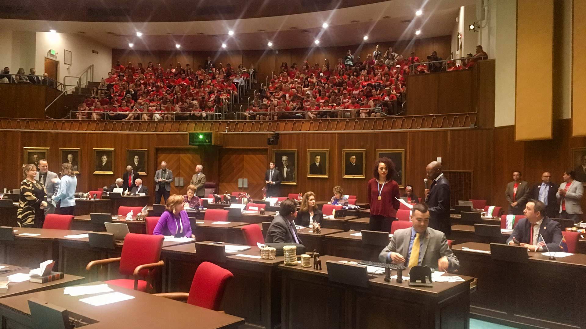 Teachers wearing #RedForEd fill the Arizona House gallery, April 20, 2018.