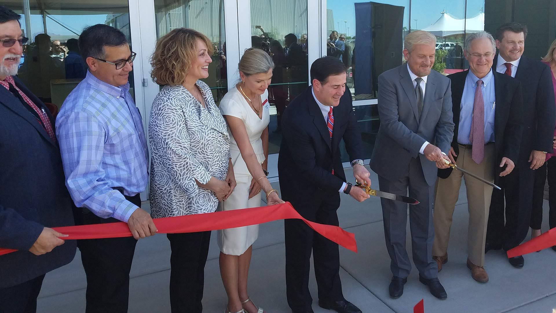 Local officials and Raytheon executives gather to cut the ribbon on the newest addition to Raytheon Missile System's Tucson facility.