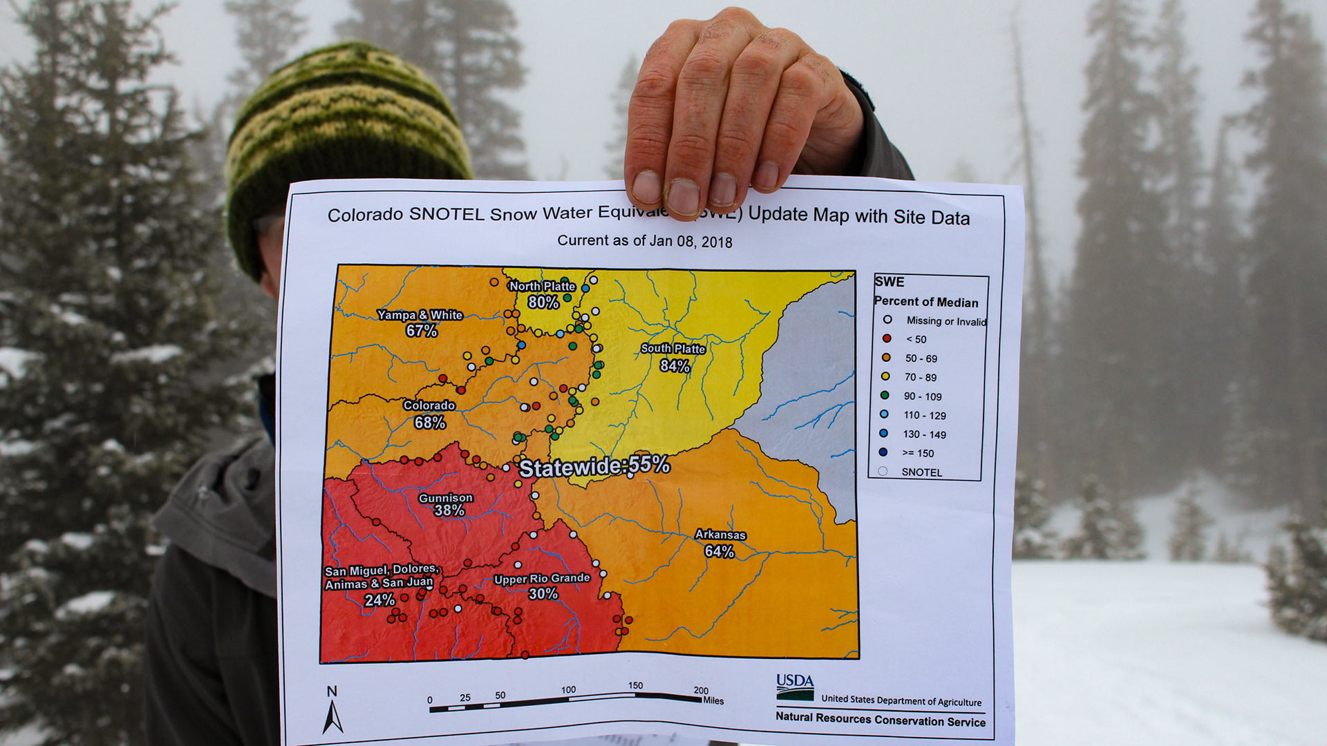 Hydrologist Karl Wetlaufer with the Natural Resources Conservation Service holds a map showing Colorado's low snowpack on Jan. 9, 2018.