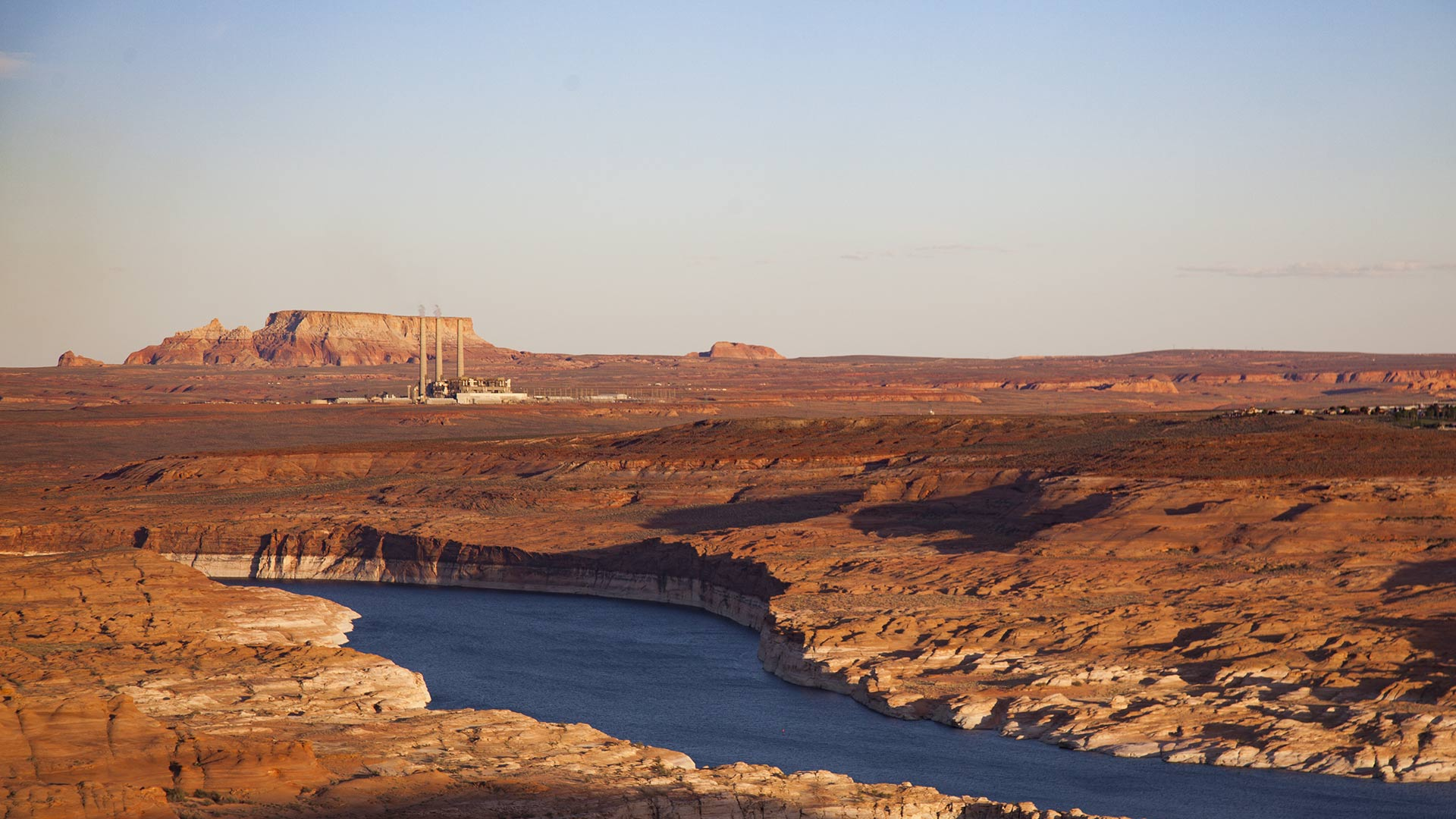 The Navajo Generating Station can be seen beyond Lake Powell near Page, Arizona, April 2018.