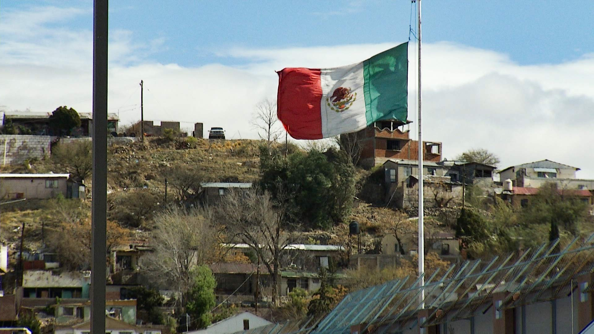 The Mexican flag flies in Nogales, Sonora.