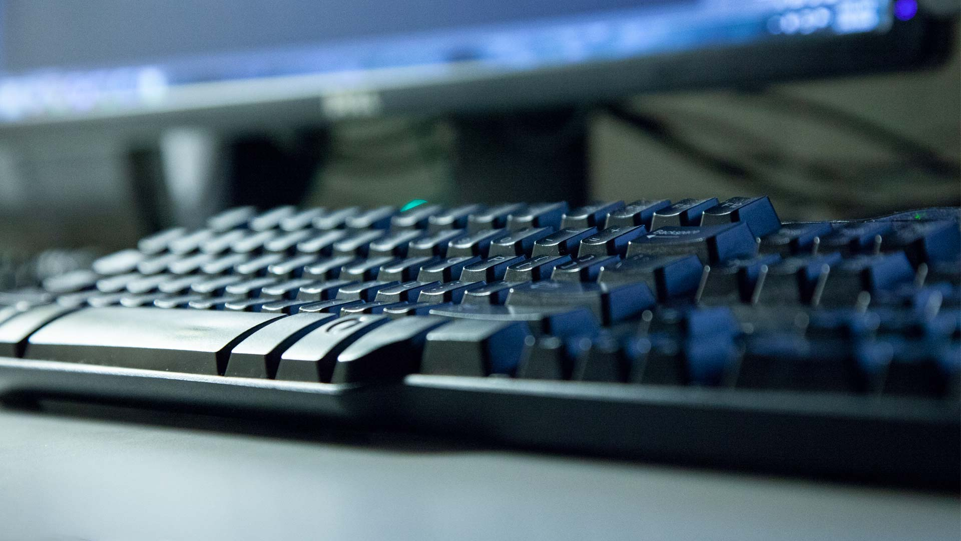 A keyboard on a desk.
