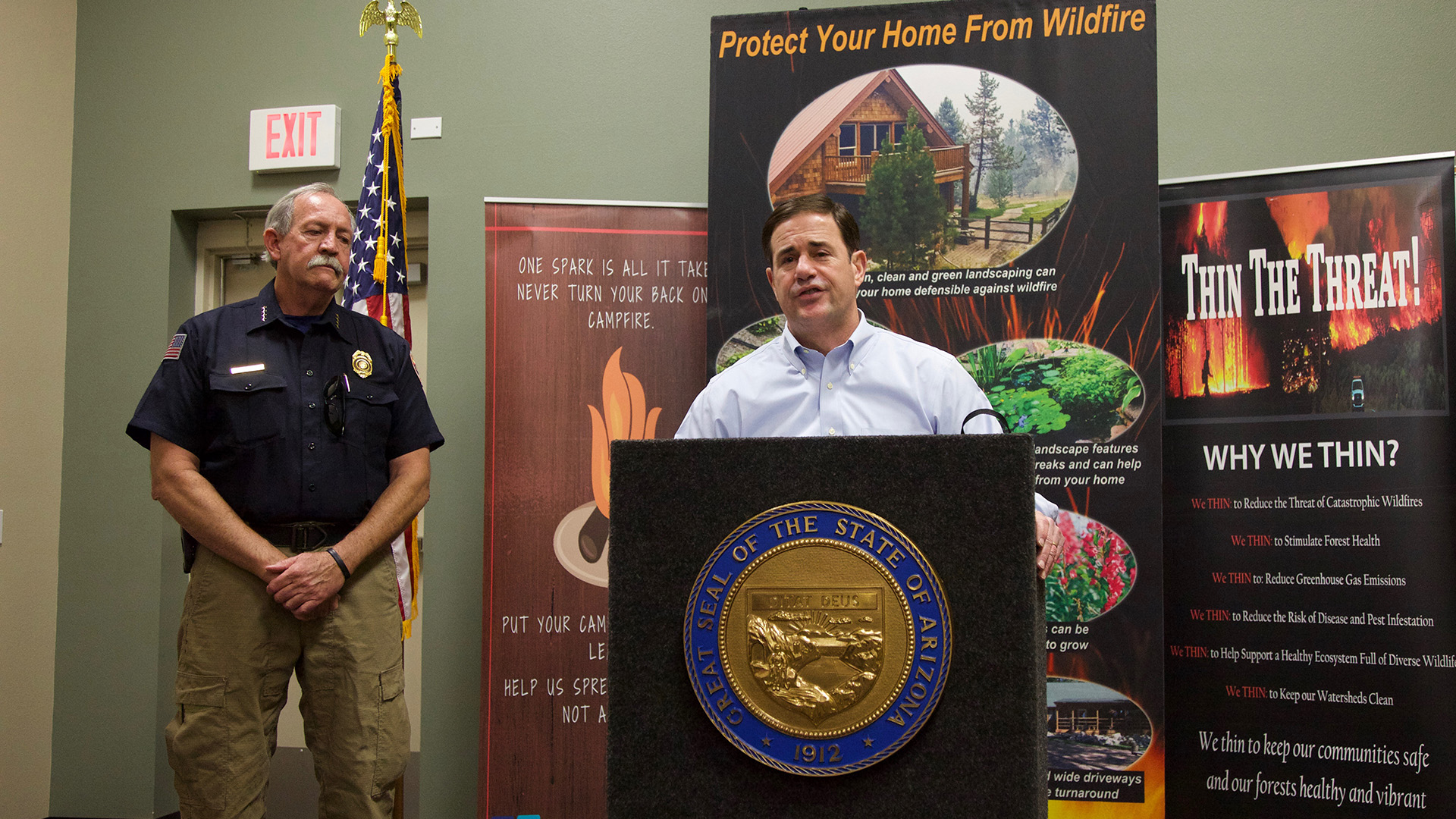 Gov. Doug Ducey, right, and State Forester Jeff Whitney speaking to a crowd of land managers and first responders in Tucson Thursday, May 31, 2018.