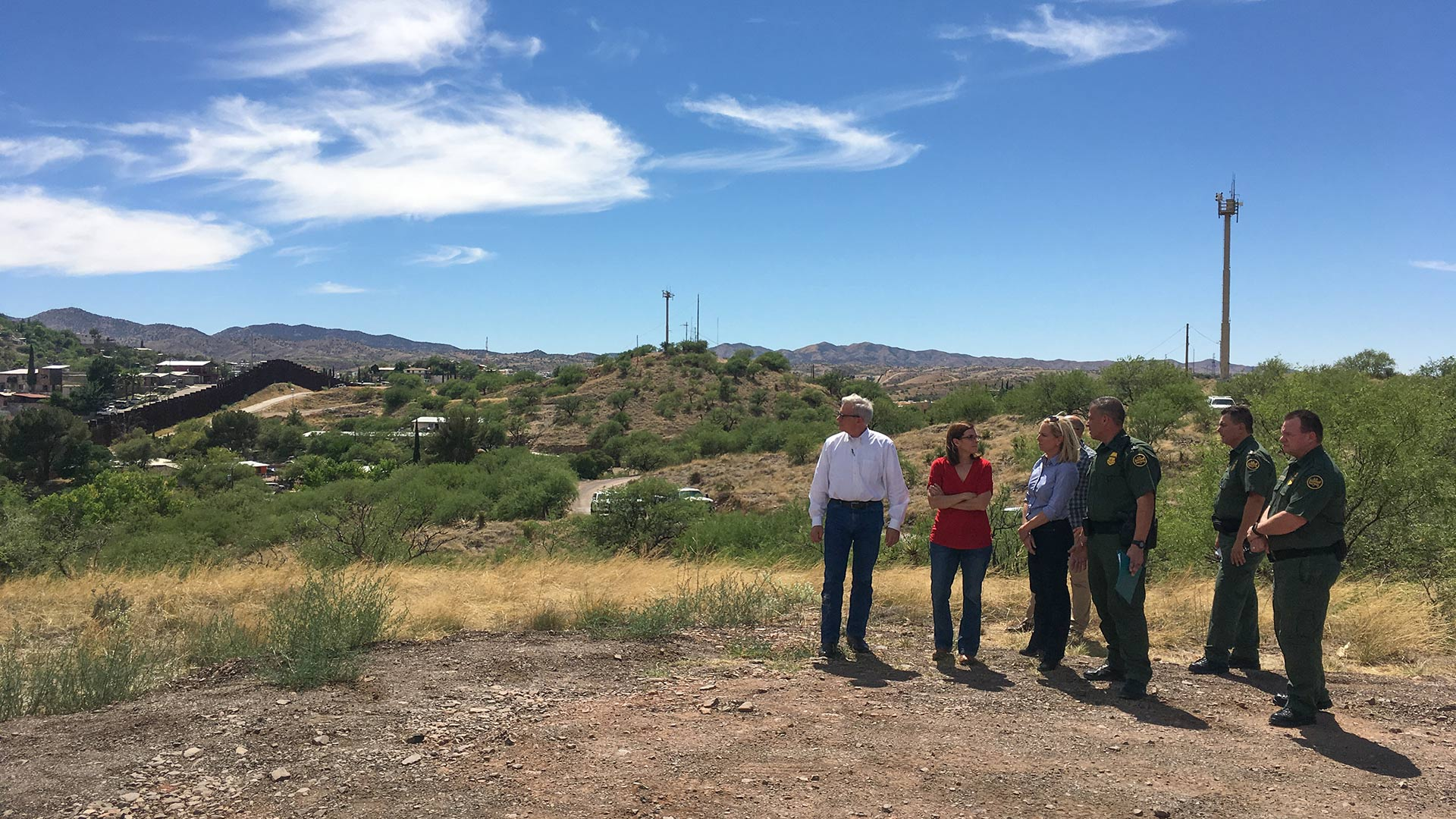 U.S. Reps. David Schweikert and Martha McSally and Homeland Security Secretary Kirstjen Nielsen are joined by  Border Patrol agents at the border fence in Nogales.