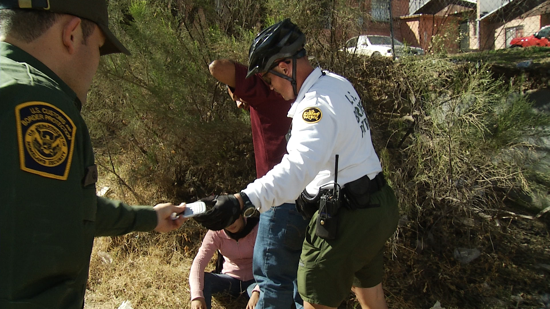 Border Patrol agents arrest a migrant couple near Nogales, Arizona, 2014.