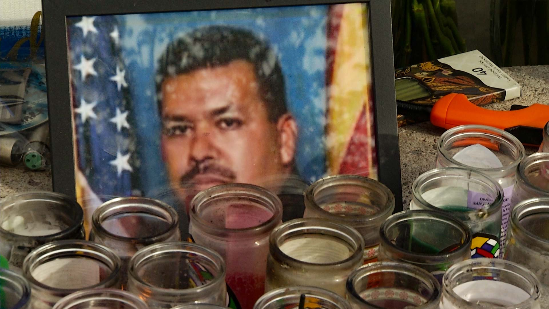 Candles burning to remember Jesus Cordova, a Nogales, Arizona, police officer killed responding to an emergency call April 27, 2018, file photo.