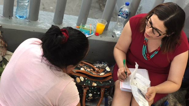 Immigration attorney Lucero Ortiz gives free legal advice in Nogales, Sonora, to a woman seeking asylum in the U.S., 2018.
