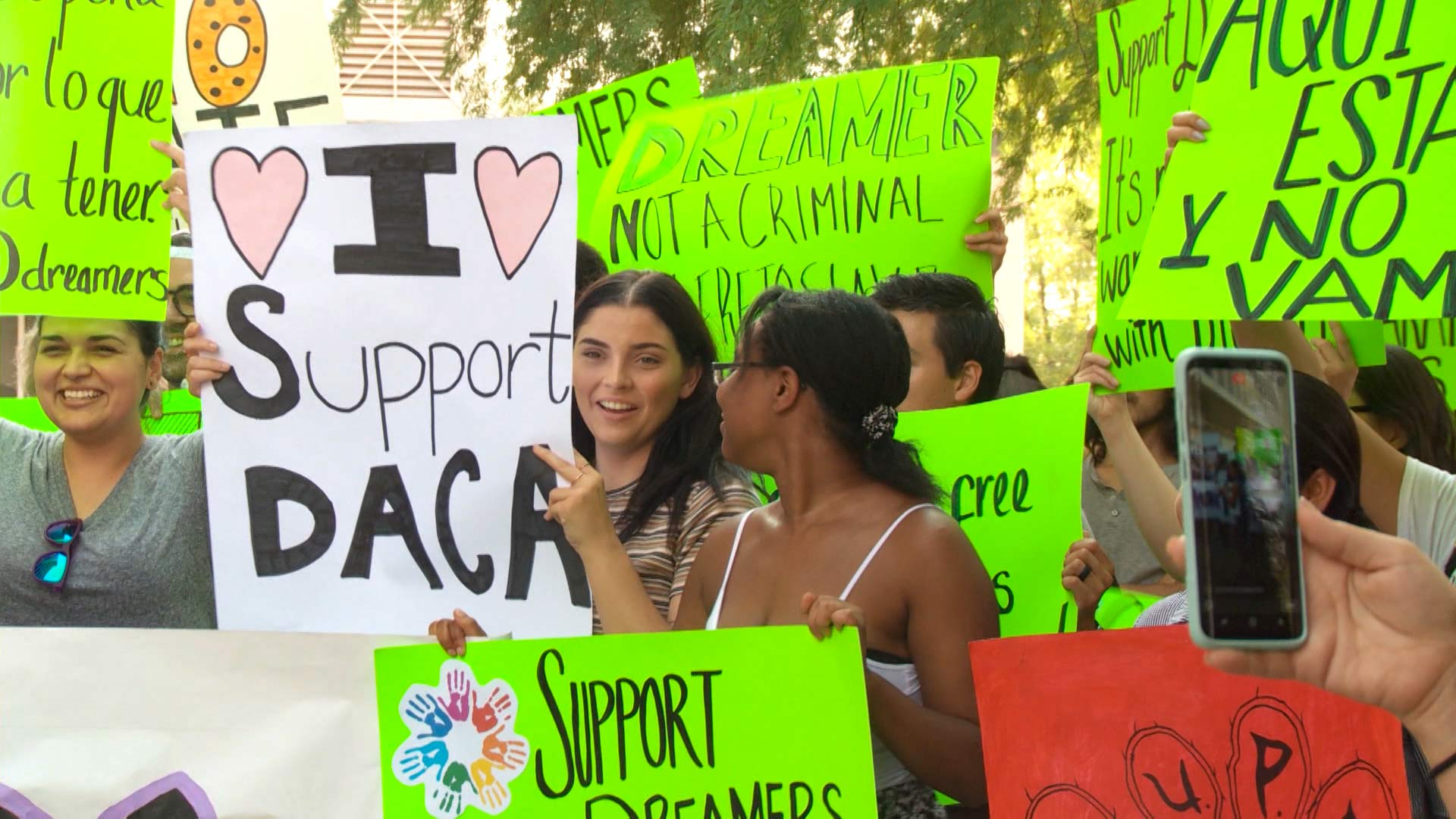 Demonstrators protest in favor of protections for Deferred Action for Childhood Arrivals recipients.