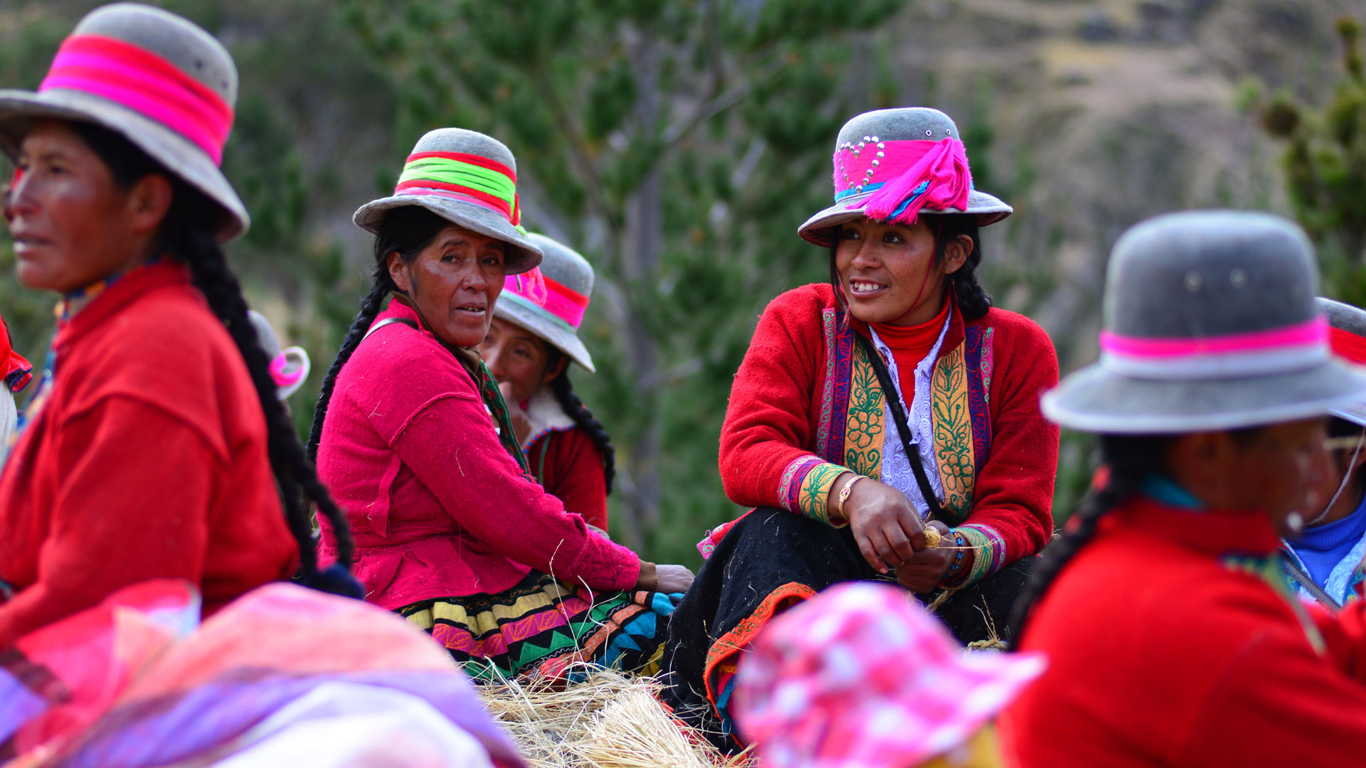 Mountain Villagers in traditional clothing, at the Q'eswachaka bridge festival, in Peru.