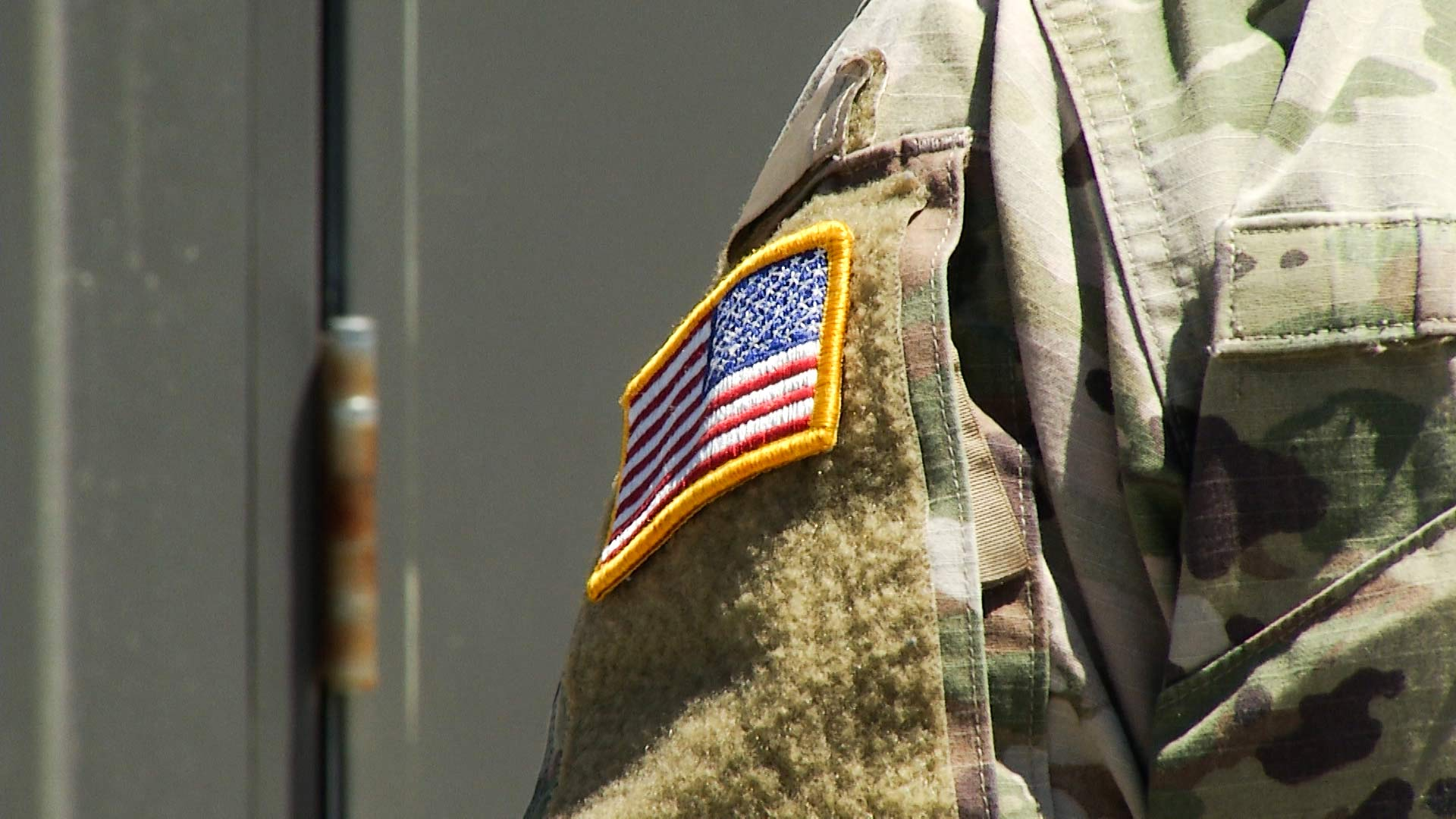 A U.S. flag on the uniform of a member of the National Guard.