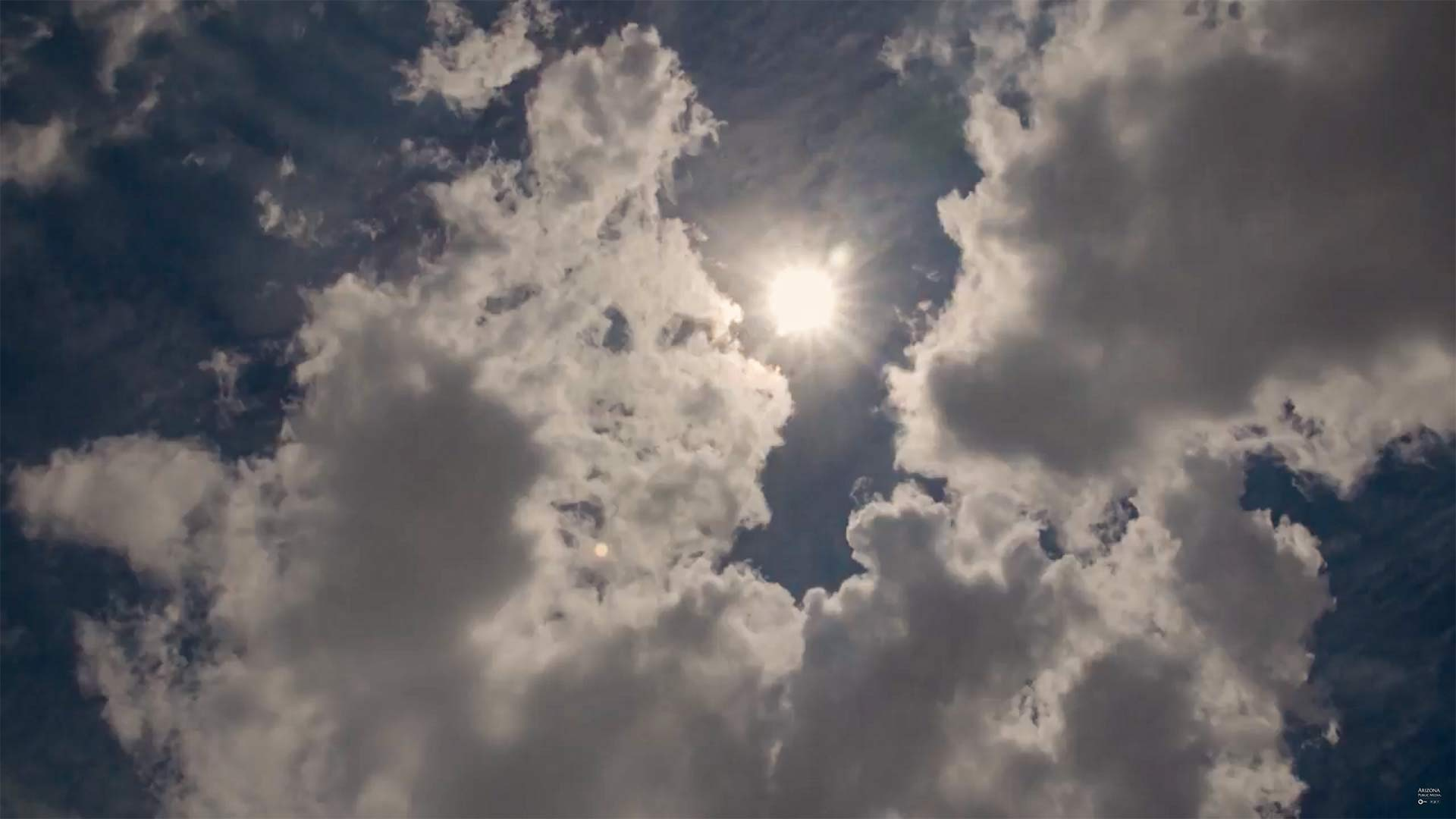 The sun peers through the clouds in Southern Arizona.