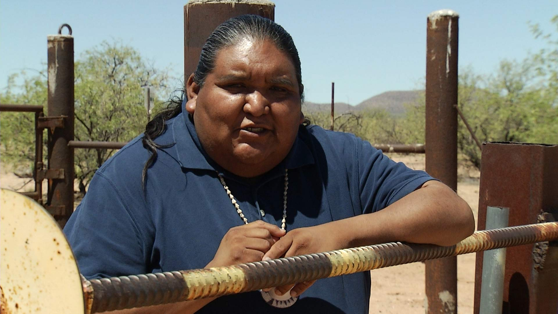 Tohono O'odham Vice Chairman Verlon Jose leans against a fence on the U.S.-Mexico border, which divides the Nation.